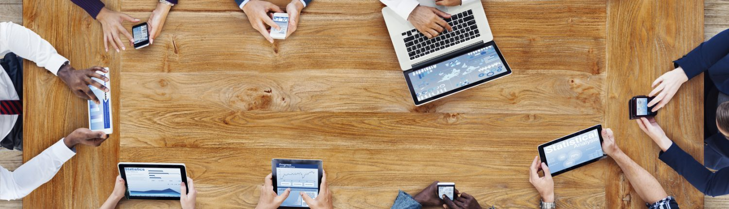 Image of people working together around a table.