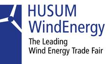 Logo of HUSUM WindEnergy, a wind energy tradeshow in Husum, Germany and former Fredricks Communications client.