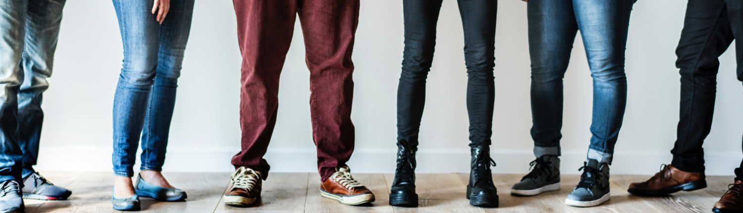 "millennials standing together on a hardwood floor. metaphor for ""the bottom line"" for ""what it costs"" page on fredricks communications website."